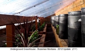 Walipini 05:                                 half sunken greenhouse in Bozeman in                                 Montana (Canada) with cold air trench,                                 thus one can manage planting and                                 harvesting in an upright position, and                                 there are water barrels at the back wall                                 storing the heat during the day and give                                 it back during the night.